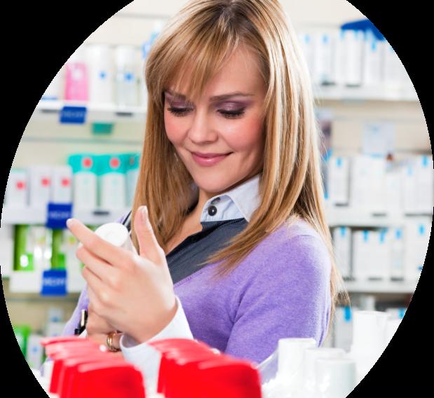woman looking at a medicine
